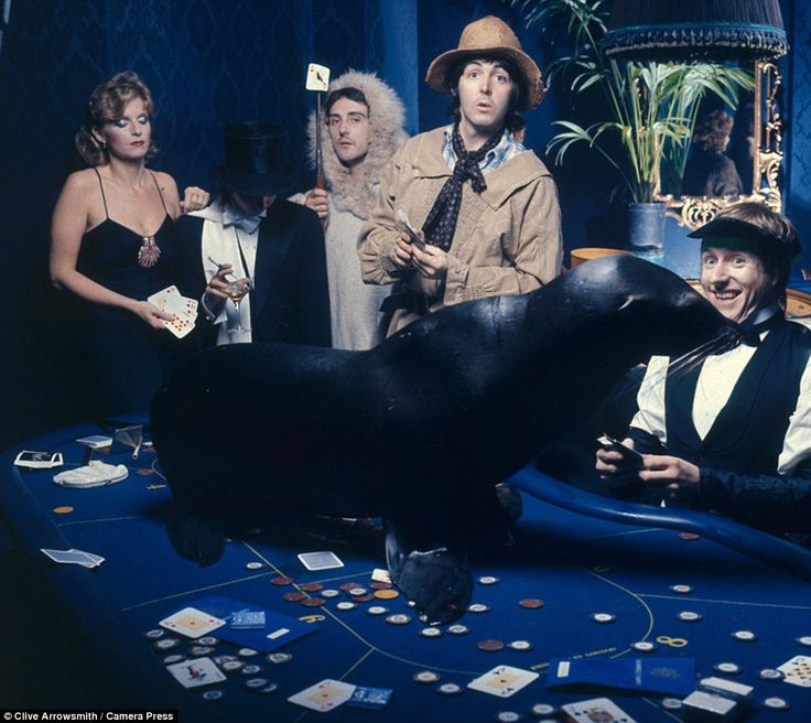Wings pose for a casino-inspired photo in 1974 (pictured Linda McCartney, Denny Laine, Sir...