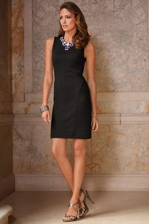 Dress is seamed for shaping with variegated rhinestone embellishments. Hidden back zip. Fully lined.