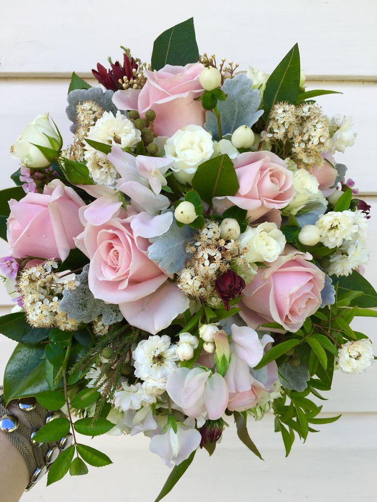 Bridal bouquet. Roses, sweet pea, hypericum berries, dusty miller and gum leaves. By Karen. Sweet Wattle Grove Florist