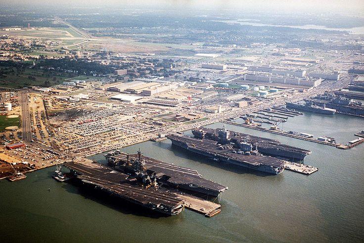 Norfolk naval base aerial 1985 with (l-r) USS America (CV 66), USS John F Kennedy  (CV 67), USS Nimitz (CVN 68), USS Eisenhower (CVN 69) and other ships