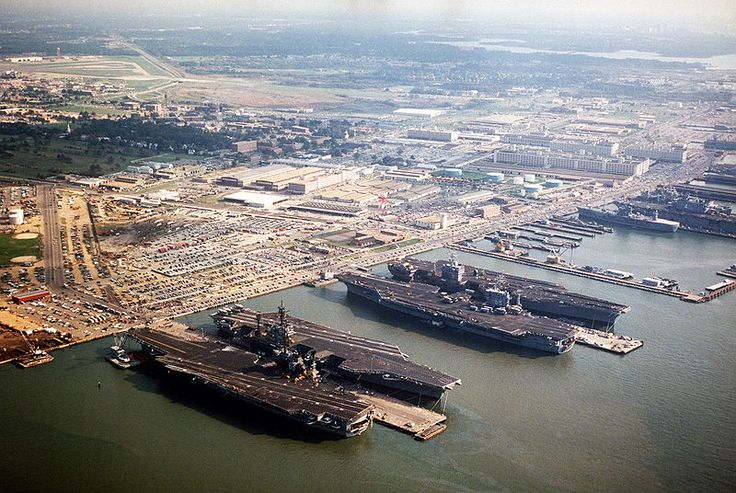 Norfolk naval base aerial 1985 with (l-r) USS America (CV 66), USS John F Kennedy  (CV 67), USS Nimitz (CVN 68), USS Eisenhower (CVN 69) and other ships