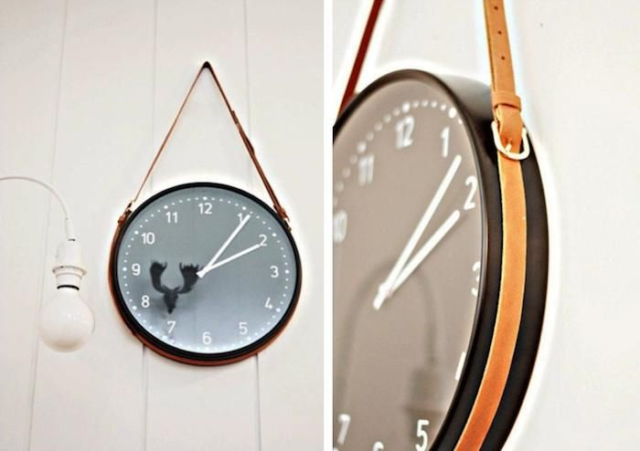 A simple Ikea Bondis wall clock suspended from a hanger made from leather belts - awesome!