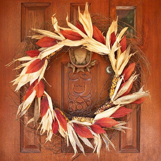 Indian Corn Fall Wreath Warm up dark doors with natural fall wreaths. To make this one, secure red silk leaves and miniature Indian corn (husks included) to a purchased twig wreath using hot glue or wire.