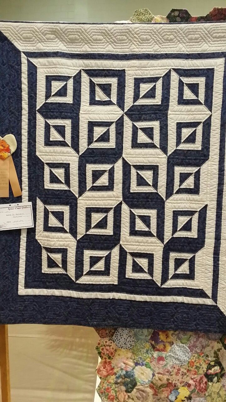 "quiltails:""Brad's Quilt"" by Cora Postlethwait. Simple design, fabulously done. With only one block and two colors, you get a lot of impact! Photo taken at Space Coast Quilt Show, Titusville, Florida, 2015."