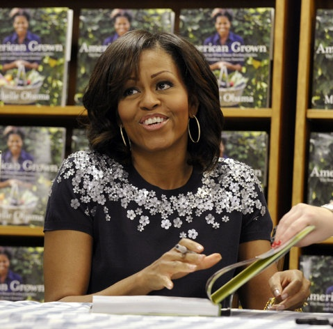 """Michelle Obama on Tuesday returned to the business of selling her first book, and she started by telling scores of people waiting in line at a popular bookstore to """"buy away"""" because Mother's Day is coming. """"It's a great gift,"""" she said of """"American Grown: The Story of the White House Kitchen Garden and Gardens Across America."""""""