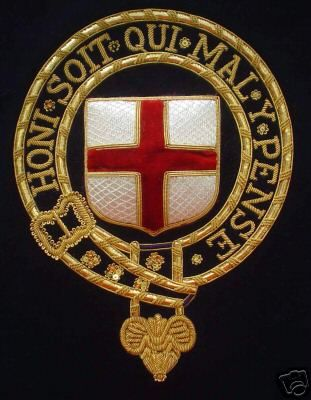 The Most Noble Order of the Garter is the highest English Order of Chivalry and is one of the most important of all such Orders throughout the world. The badge is presented on a square patch of dark blue velvet which could be used to frame this item. Embroidered by hand in 2wm gold wire and 90% silver, this Order is worn on the left side of the mantle, and depicts a shield of the arms of St George (Argent a Cross Gules) within the Garter which is shown buckled and edged with gold e