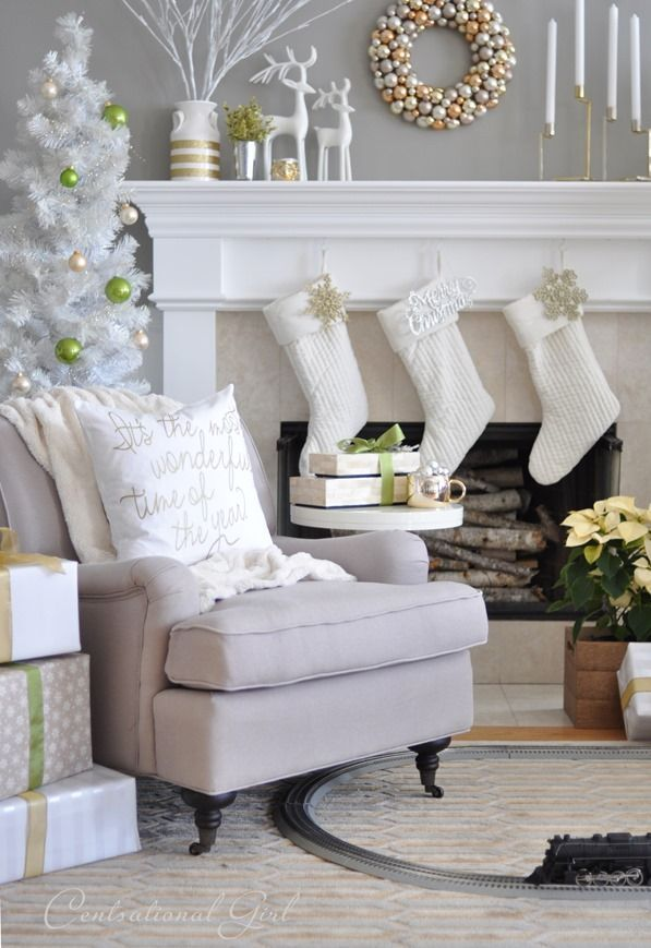 Holiday decorating & ideas - Christmas mantel decor in bright white with gold and green accents | Mixed Metallics Christmas Mantel | Centsational Girl
