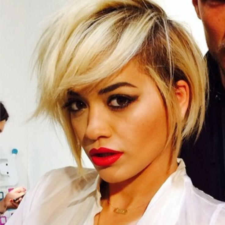Rita Ora got an edgy new haircut during Milan Fashion Week. See the pictures of her with short hair.