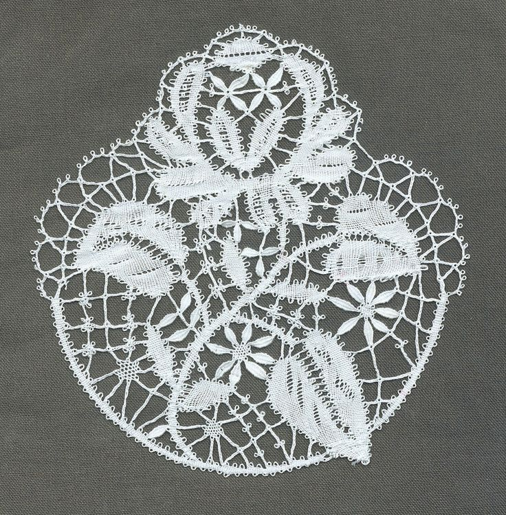 Anita Harris's motif from a Lester handkerchief. I started at the top rather than at a sensible point, and keeping the rows in the rose flat was a pig. Bedfordshire.