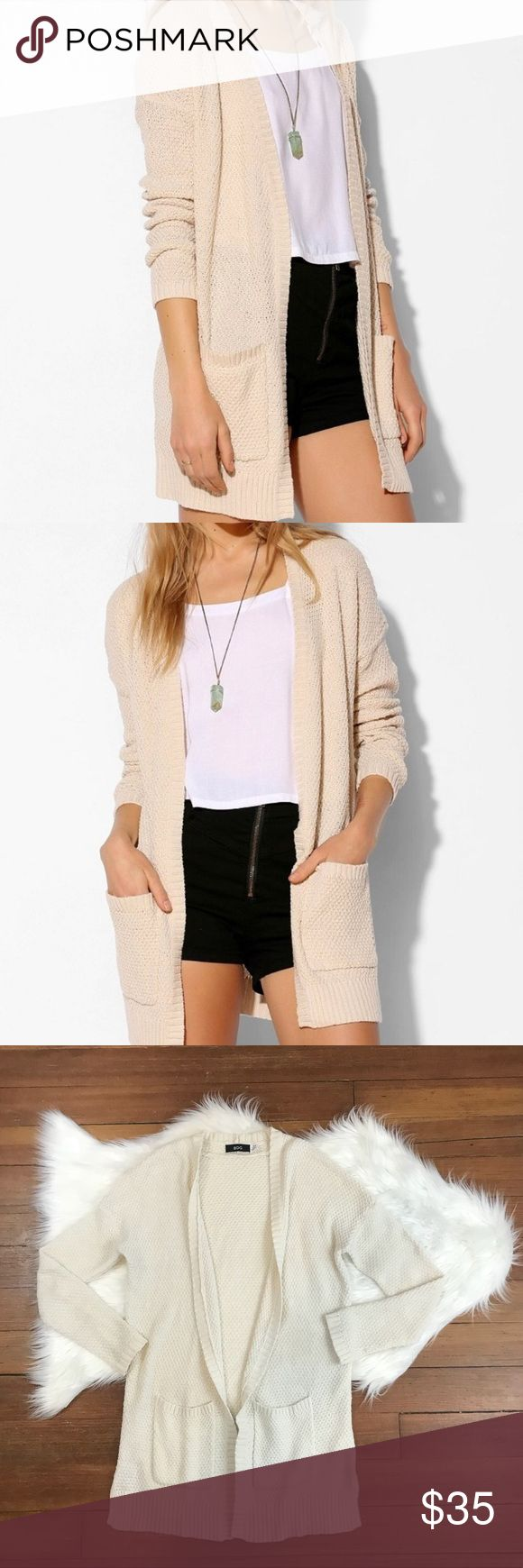 UO BDG Open Front Cream Knit Pocket Cardigan Urban Outfitters BDG Cream Knit Cardigan. Open front design with 2 pockets. Versatile & perfect with any ensemble. Size S. In excellent condition, no holes, stains, etc. Open to offers. Bundle your likes and I'll send you an extra discounted offer! Urban Outfitters Sweaters Cardigans