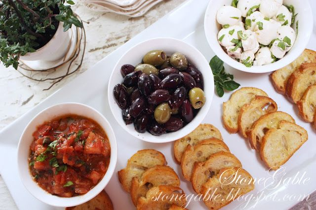Deli hors d'oeuvres: three distinct flavors is plenty. Tomato bruschetta, oil cured olives and soft cheeses with toasted baguettes. Cut up a day old baguette, brush with olive oil and put into a 400 degree oven for 15 minutes until just golden brown and crisp. | Stone Gable