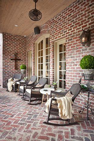 Patio With Brick Walls And Herringbone Brick Floor