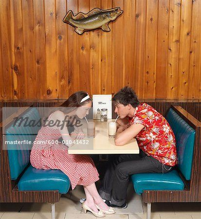 Stock photo of Couple Sitting in Diner; Premium Royalty-Free, 600-01041432 © Masterfile. All rights reserved.