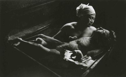 """W. Eugene Smith - """"Tomoko Uemura in Her Bath"""" Japan, 1971. Minamata disease, caused by the release of methyl mercury in the industrial wastewater from the Chisso Corporation's chemical factory, continued from 1932 to 1968. Eating mercury poisoned fish caused birth defects. Here, a mother bathes her affected daughter."""