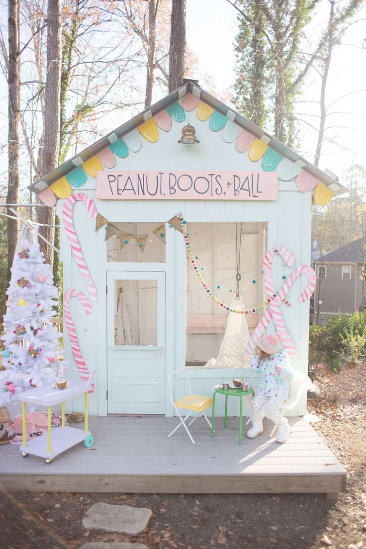 Surprise your kids by turning their playhouse into a gingerbread house for the holidays. So fun!