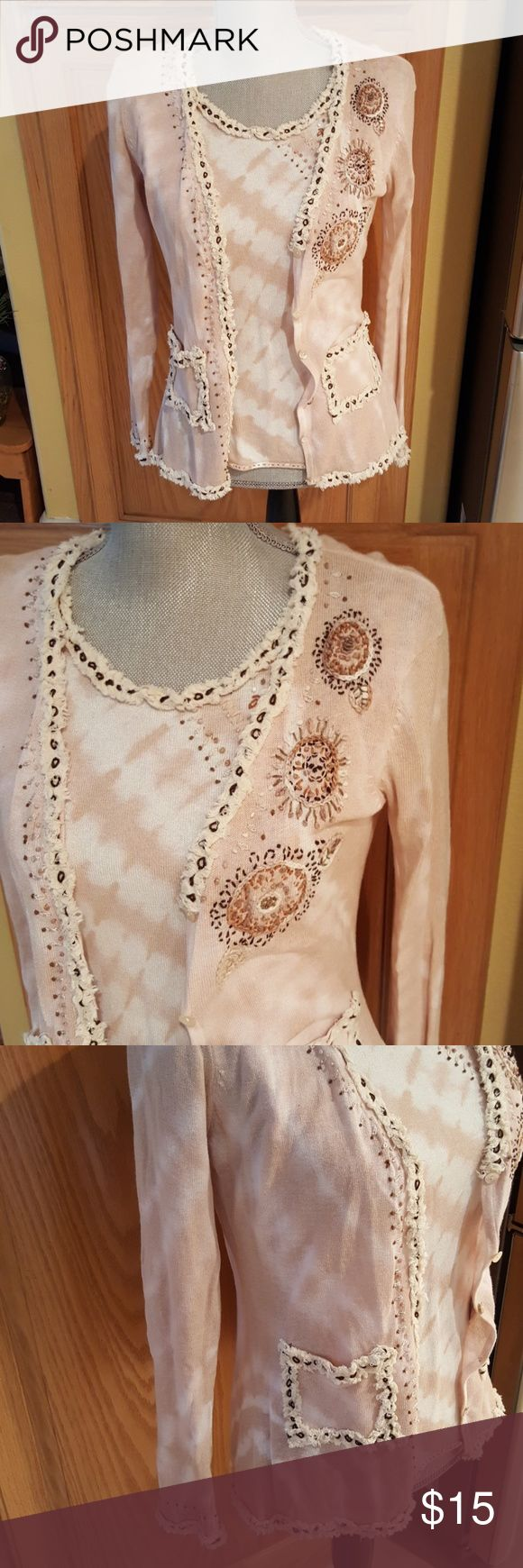 Beautiful sweater set. Size L Very unique sweater set. Bead embellishments in excellent condition.  TTS. Neutral colors to compliment your wardrobe.  Feel free to ask any questions prior to purchase.  Long sleeve outer sweater and sleeveless shell.   Bundle discount available.  All reasonable offers accepted.  Non-smoking home. Anthropologie Sweaters