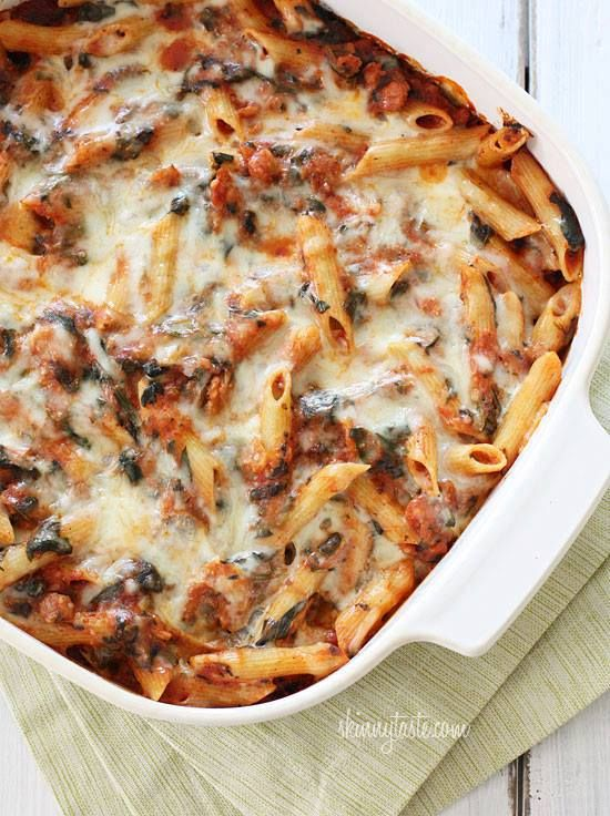 Baked Pasta with Sausage and Spinach(Directions  Ingredients: olive oil spray 1/2 cup grated Pecorino Romano 8 oz fat-free ricotta 8 oz part-skim mozzarella, shredded 14 oz uncooked sweet Italian chicken sausage, removed from casing 12 oz high-fiber or low carb rigatoni pasta 1 tsp olive oil 2 cloves smashed garlic, roughly chopped 10 oz package frozen chopped spinach, thawed and squeezed of excess liquid salt and fresh pepper to taste 4 cups Quick Marinara Sauc