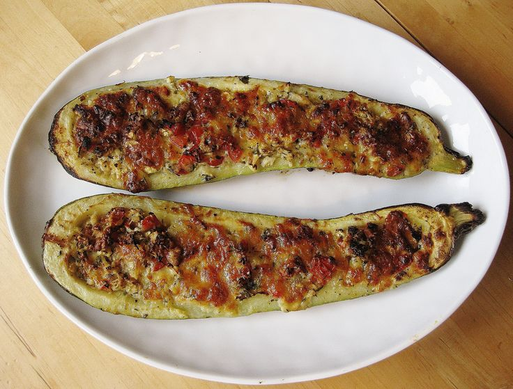 Stuffed courgettes with tomatoes, basil and parmesan http://theproofofthepudding.net/2014/08/15/vegetarian-stuffed-courgettes/