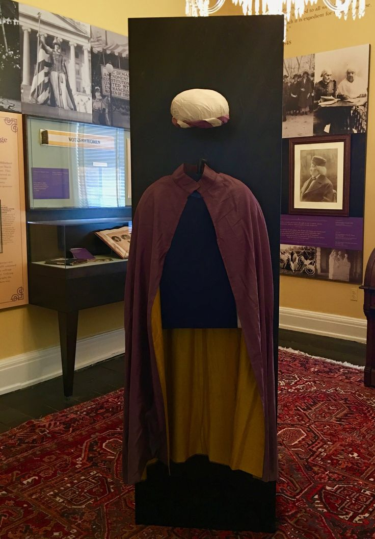 Displayed here is a cape and cap worn by suffragists at pageants and parades. Purple, white and gold were the official colors of the National Woman's Party.