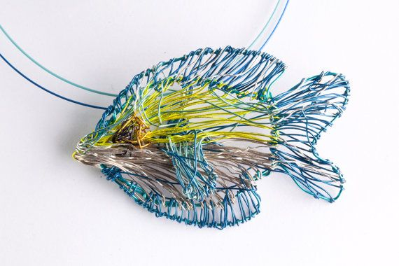 Fish necklace, lemon yellow blue necklace, wire sculpture art fish pendant, ocean animal jewelry, boho, Summer, Winter, unusual gift for her  Handmade lemon yellow, bluefish pendant necklace, The wire sculpture, ocean animal, summer, art necklace, made of colored copper and silver wire. The height of the necklace is 2cm (0,79in), and the width of the unusual gift for her is 4,2cm (1,65in) The art gift necklace hanging from steel wire and the clip is handmade silver. Very easy and safe to…