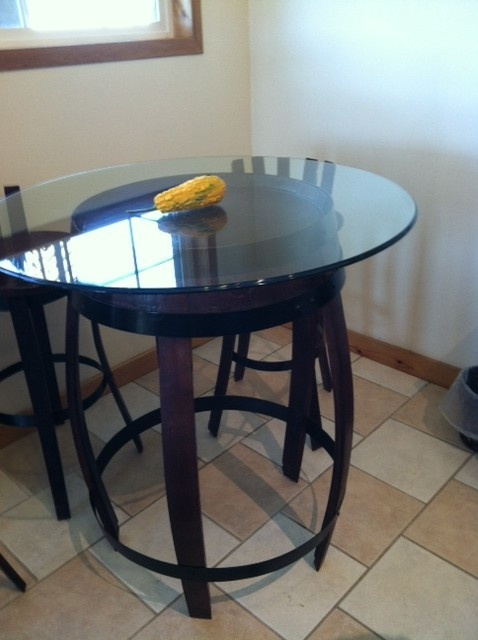 Bistro table made out of wine barrel, also comes with wooden table top, made by Gepetto.