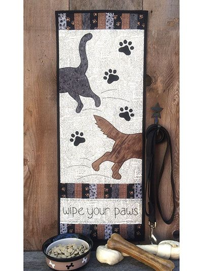 """Perfect banner for animal lovers!   Only clean paws and feet are allowed after you hang up this adorable quilt! Perfect for cat and dog lovers, you can mix-and-match cat and dog appliques to customize. Finished size is 11 1/2"""" x 30""""."""