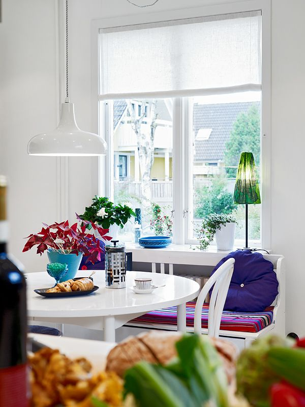 white dining room, nook, bentwood chair, table, window seat, pendant light, window, color: