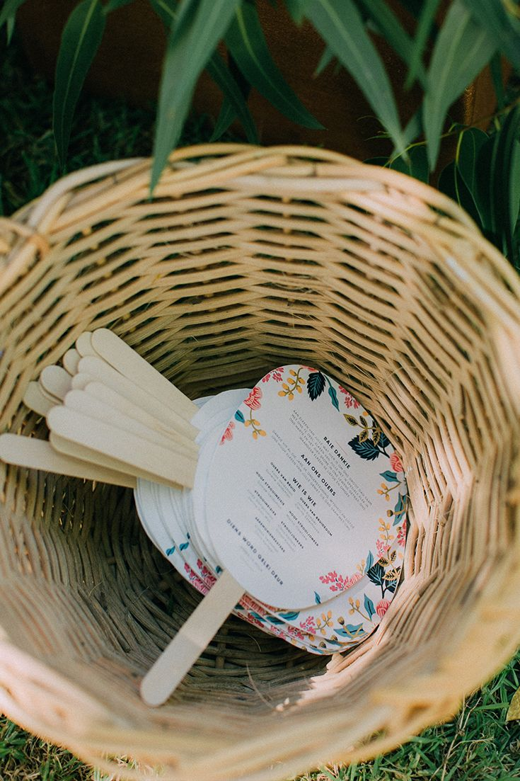 I love this idea for the wedding ceremony program. It doubles as a fan on a hot day :) Beautiful floral wedding stationery ideas with soft pinks, turquoise and navy. Designed by the bride herself. For more of this boho garden wedding go to http://michelledt.com/hestre-johan/