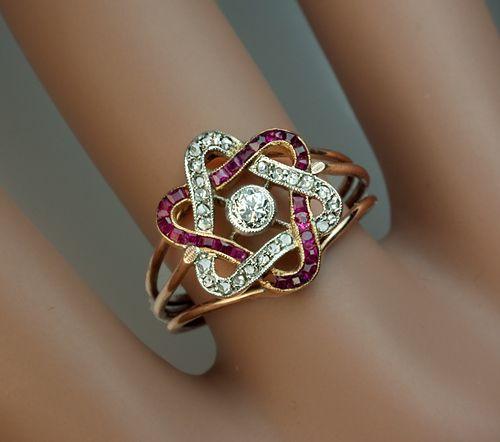 A very elegant Belle Epoque engagement ring, circa 1910. Rubies, diamonds, platinum, gold, rose gold band.