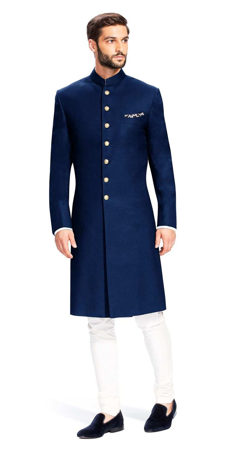 Gurhkan Midnight Blue: This Midnight Blue Achkan is regal and distinguished. It is made using Italian fabric from Vitale Barberis Canonico.  Featuring buttons that are cut from solid brass, rough buffed and plated in 24 carat gold. Rs. 35000.