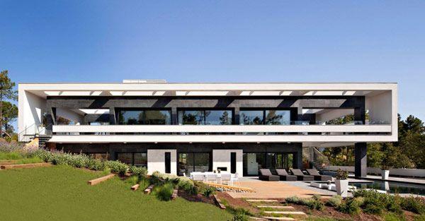 La Vinya is a massive residence designed by studio Lagula Arquitectes and located in Caldes de Malavella, Spain.