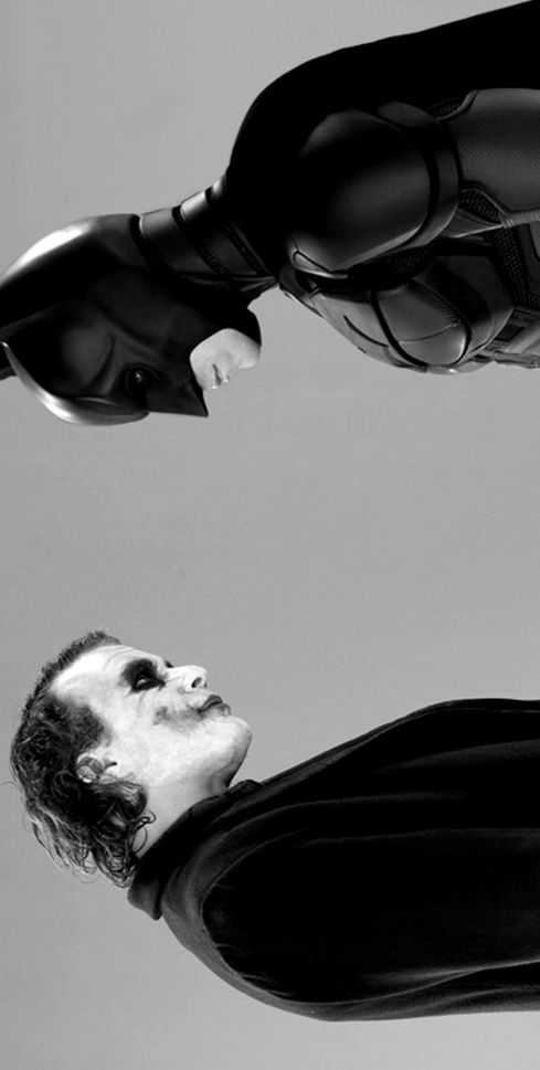 THE DARK KNIGHT: Heath Ledger as The Joker and Christian Bale as Batman/ Bruce Wayne