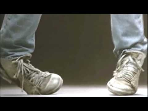 Kenny Loggins - Footloose.  The original version with Kevin Bacon.  The shoe styles in this video crack me up.  What were we thinking?!  Lol