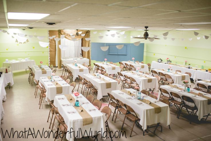 Reception Hall for wedding- I love the fun atmosphere the lace and twine bunting at the ceiling, the burlap on the tables and the antique vibe of all the slightly different table settings. So cute!