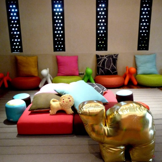 Awesome playroom. Love the cushions and dog chairs and LOVE the gold camel