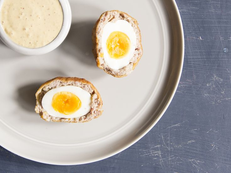 Boudin Scotch Eggs - Wrap soft-boiled eggs in boudin sausage, roll them in bread crumbs, and then deep-fry them. Serve them with a spicy rémoulade sauce. www.saveur.com/boudin-scotch-egg