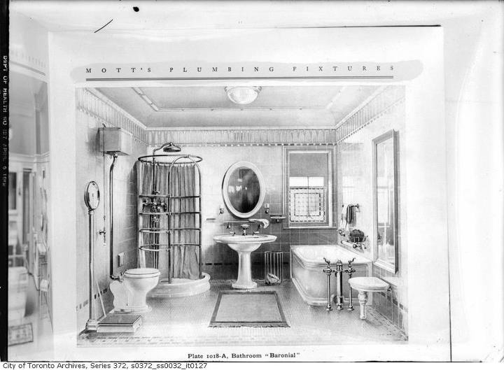 Nice bathroom...especially for 100 years ago.  Love the birdcage shower!