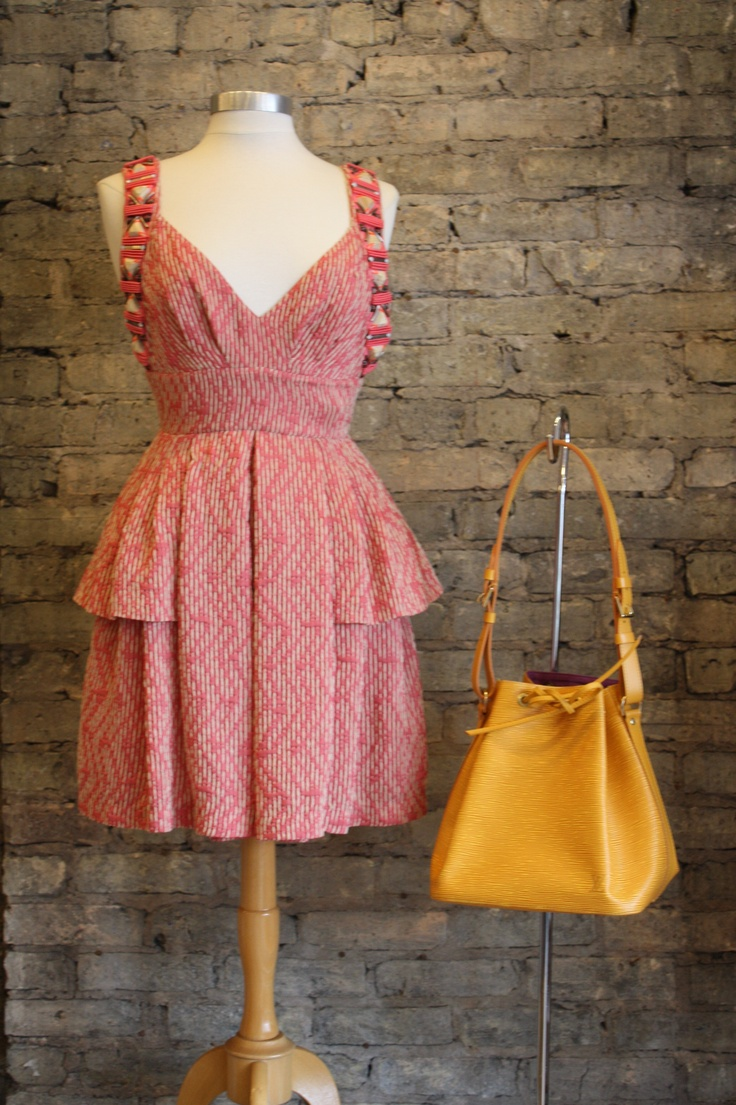 Louis Vuitton epi-leather champagne bag, Matthew Williamson dress. Adorable!