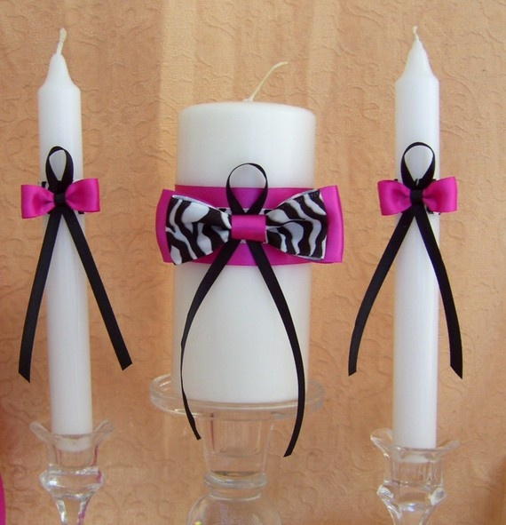Zebra print themed wedding unity candle and tapers set - You can choose a different accent color.  Lovely! http://www.etsy.com/transaction/44895204 More zebra wedding ideas:  http://www.squidoo.com/leopard-zebra-wedding