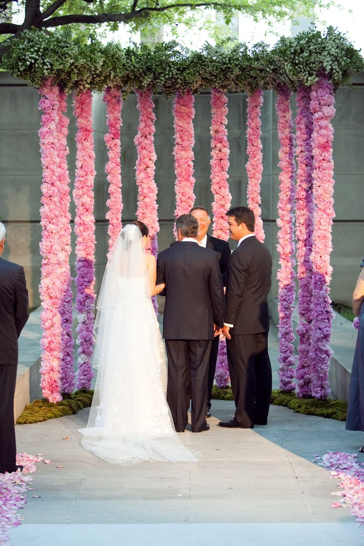 Love the backdrop with pink floral hanging garland. #wedding #garland #ceremony #pink