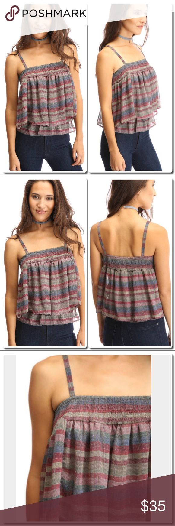 """Double Layer Stripe Top Trendy and sexy, but also playfully sweet, this double layered top lends a colorfully striped shell, smocked bodice, subtle metallic details, and relaxed fit.   Double layer top Multi colored striped print Subtle metallic details Relaxed fit 98% polyester / 2% metallic Dry clean recommended Measures approximately 24"""" from shoulder Model shown wearing size small (S) Tops Tank Tops"""