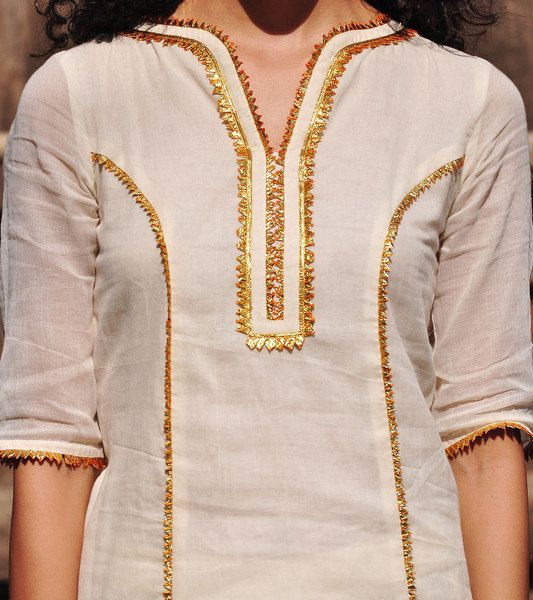 Our ivory and gold Sharara set has an old world charm with its delicate and lightweight finish in soft mulmul fabric. Its well tailored and finely