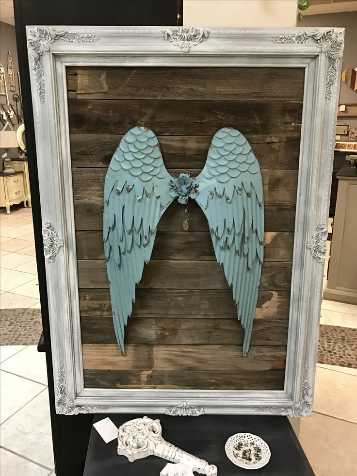 Angel wings metal on old reclaimed wood in a fancy vintage frame. By Gilbert Marketplace #m42 #Gilbertmarketplace