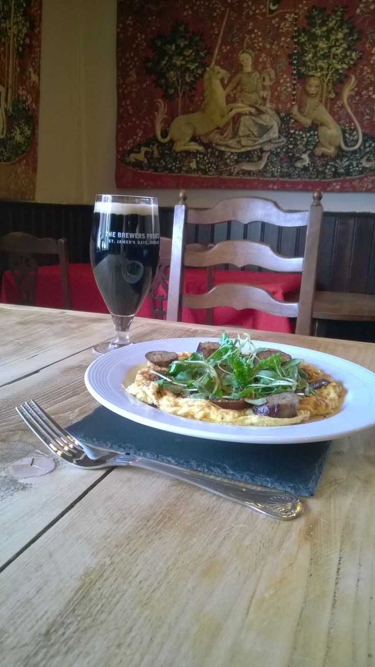 Omelette with sausage, mushrooms and watercress.  Washed down with a glass of chilled Dublin Porter.