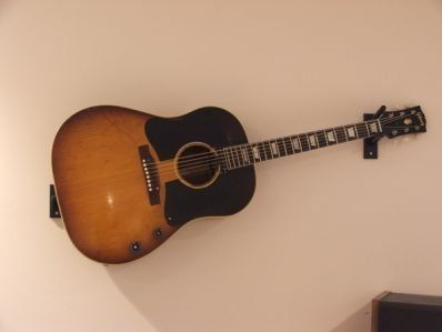 Standard Horizontal Acoustic Guitar Mount by Guitar Ideas, http://www.amazon.com/dp/B001P20IFY/ref=cm_sw_r_pi_dp_RSTgqb0C7YRRX