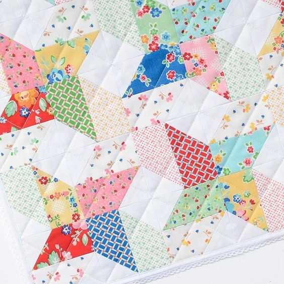 Beautiful quilt made with Arbor Blossom fabric designed by Nadra Ridgeway for Riley Blake Designs