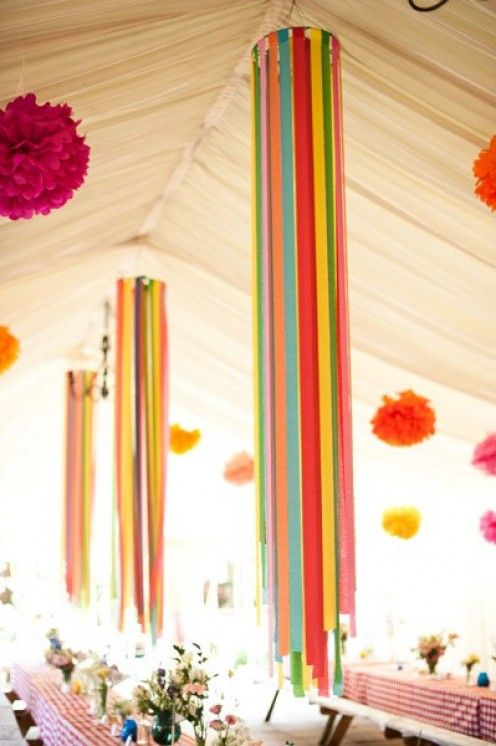 Use inexpensive embroidery hoops. Cut streamers at varying lengths & insert between hoop's rings. Tighten & hang.    Hang them in the trees at wedding reception.