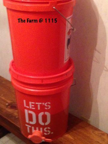 Honey Extracting: Bucket Method - Stacked honey extracting buckets.