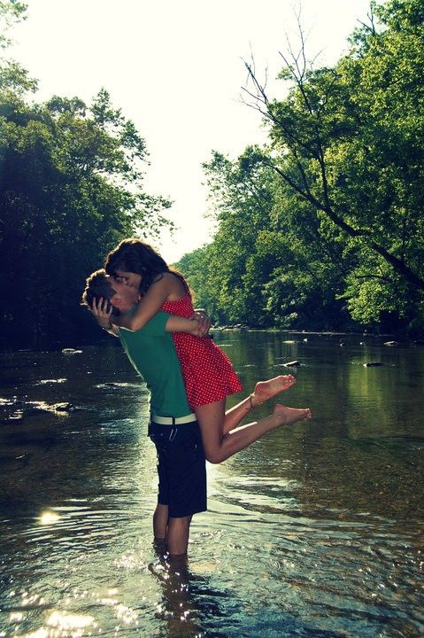 Engagement photos in a river. Love it.