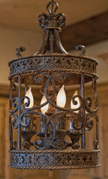 such a beautiful iron ornate Tuscan pendant light fixture.  Front entrance